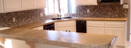 Kitchen with Pebble Stone & Travertine